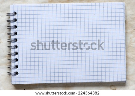Open notepad with spiral shabby paper texture - perfect background with space for text or image - stock photo