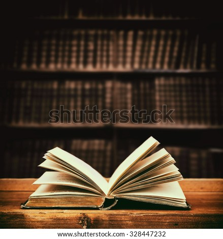 open old book in a library. - stock photo