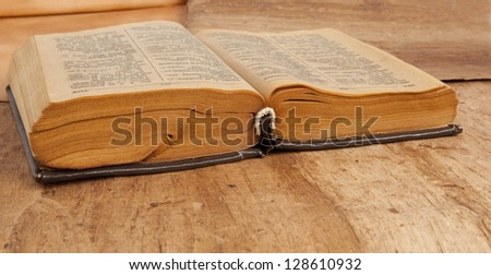 Open old vintage book on wooden background