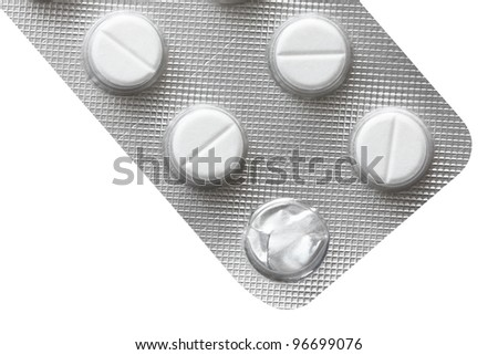 Open pack of pills isolated on white background - stock photo