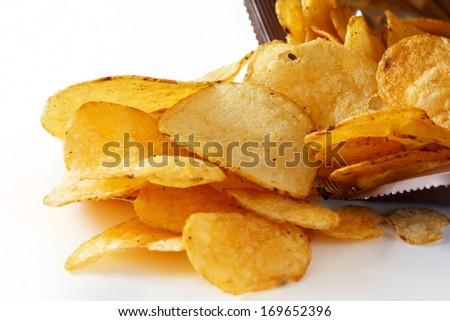 Open packet of crisps on white - stock photo