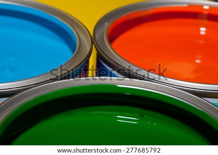 Open paint cans with green, blue and red color - stock photo