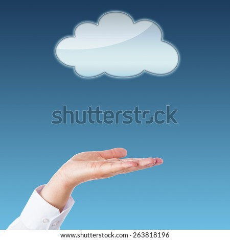 Open palm of a hand of a business person facing upward towards a void cloud icon above. Do place your product or artwork in the center! Metaphor for cloud computing. Copy space. Blue background. - stock photo