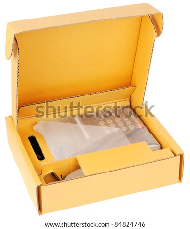 Open pasteboard box with new telephone isolated on the white