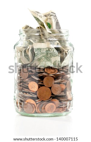 Open penny jar with bank notes over white background