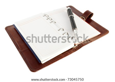 Open personal organizer, with pen, on white background. - stock photo