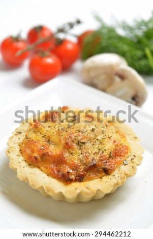 open pie with a cheese crust on a white plate - stock photo