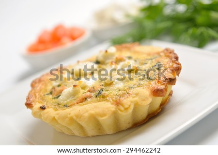 open pie with feta cheese on a white plate - stock photo