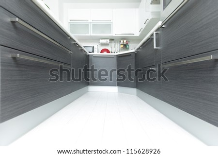 Open-plan kitchen interior perspective in modern home - stock photo