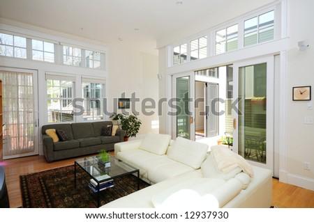 Open plan living room in modern condo apartment - stock photo