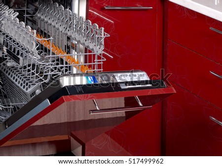 open pure empty dishwasher in kitchen furniture red