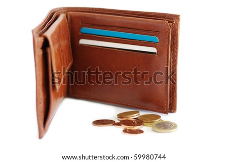open purse on a white background with scattered coins - stock photo