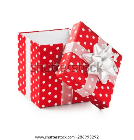 Open red gift box with white dots and ribbon bow. Holiday present. Object isolated on white background. Clipping path - stock photo