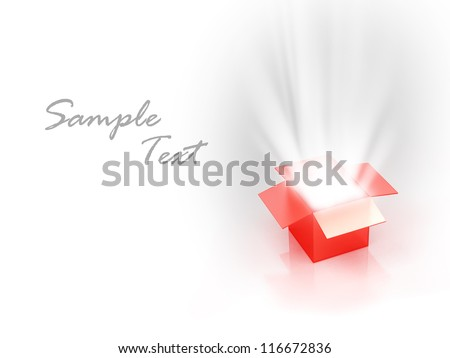 Open red present box with a magical light coming from the inside - stock photo