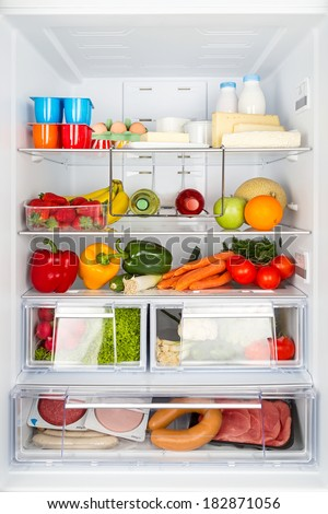 open refrigerator filled with food - stock photo