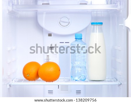 Open refrigerator with diet food - stock photo