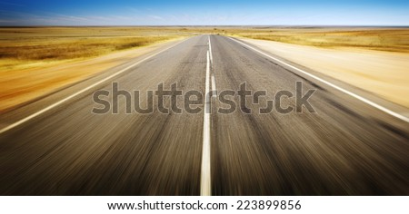Open road ahead, endless road blur for concept - stock photo