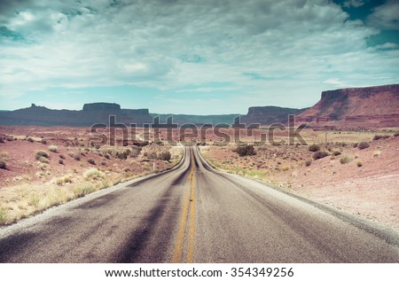 Open Road and possibilities. Road in Arches National Park. Artistic Instagram style processing. - stock photo