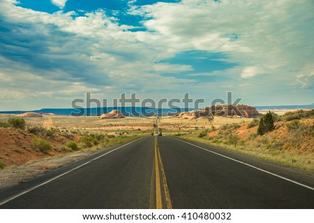 Open Road and possibilities. Road in Death Valley National Park. Artistic Instagram style processing. - stock photo