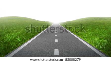 Open road highway with green grass and asphalt street representing the concept of journey to a focused destination resulting in success and happiness. - stock photo
