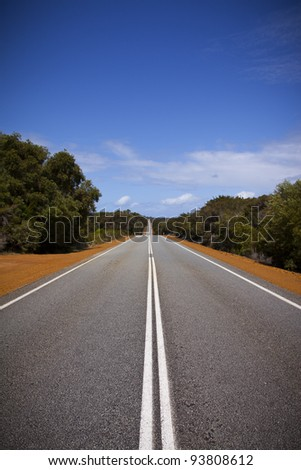 Open road in Australia stretching into distance. Portrait. - stock photo
