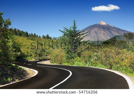 Open road on Tenerife. Winding mountain road in beautiful landscape on Tenerife showing the volcano Tiede. - stock photo