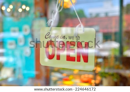 open sign broad through the glass of window at coffee shop - stock photo