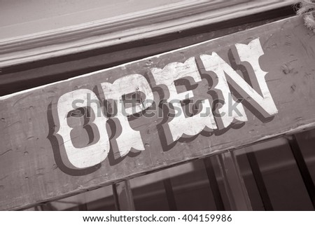 Open Sign in American Style Font in Black and White Sepia Tone