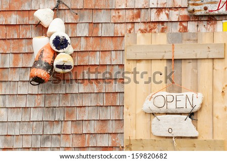 Open sign on craft store in Peggys Cove, Nova Scotia - stock photo