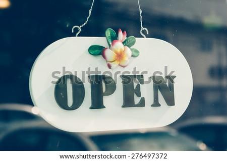 open sign on glass door - stock photo