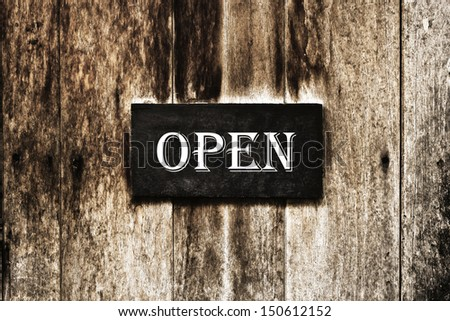 Open sign pinned onto a painted wooden door - stock photo