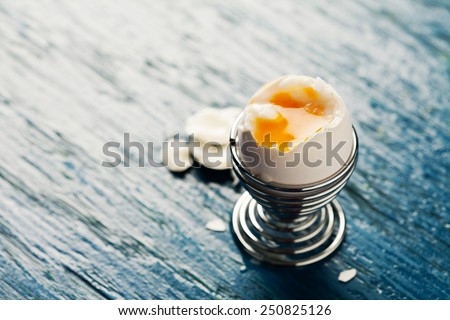 Open soft boiled egg in egg cup - stock photo