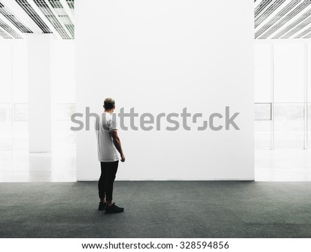 Open space gallery interior with empty canvas. - stock photo