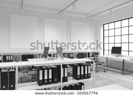 Open space office, big window to the right, tables with computers, office chairs, shelves with folders, lamps on the ceiling, three white boards on the wall. Concept of work - stock photo