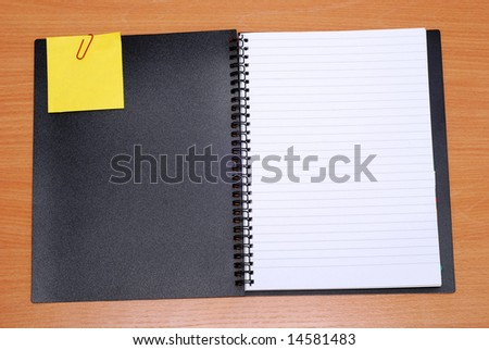open spiral notebook and empty note isolated on white