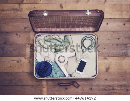 Open suitcase with vintage style objects