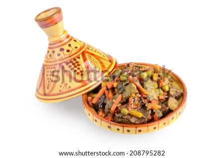 Open tajine full of meat and vegetables on a white background
