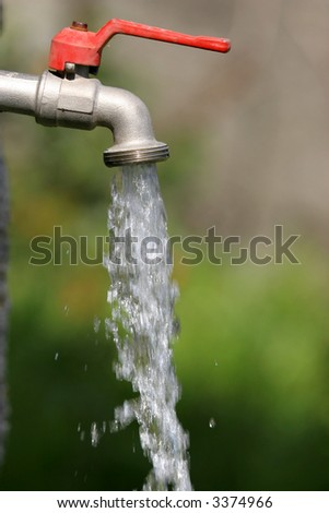 open tap with running water - stock photo