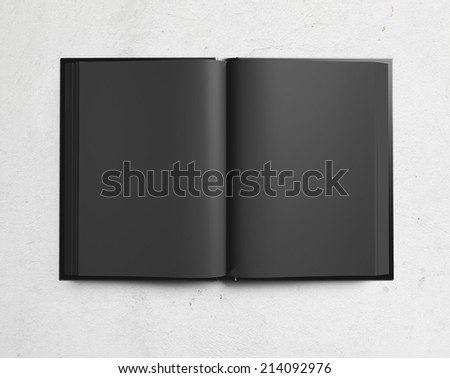 Open textbook with black pages - stock photo