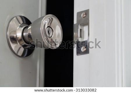 Open the door knob inside the darkroom - stock photo