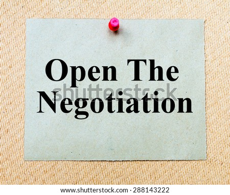 Open The Negotiation written on paper note pinned with red thumbtack on wooden board. Business conceptual Image - stock photo