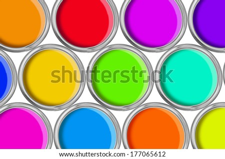 open tin cans with paint, colorful background - stock photo