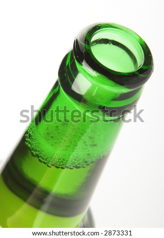 Open top of beer bottle, close up. - stock photo