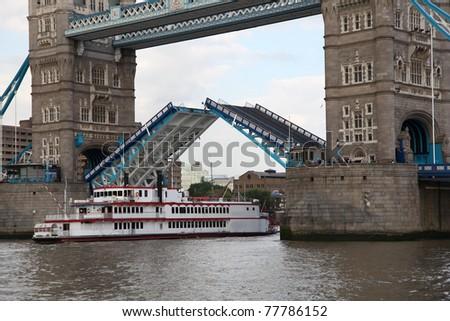 Open Tower Bridge with steamboat, London, UK - stock photo