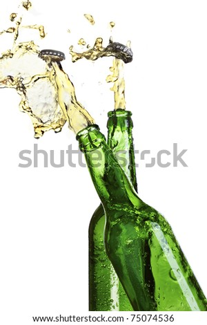 Open two bottles of beer with an explosion - stock photo