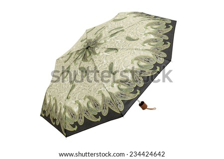 Open umbrella with abstract green cashmere elements isolated on white with clipping path - stock photo