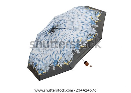 Open umbrella with flowers isolated on white  - stock photo