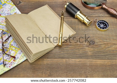Open Vintage Notebook With Blank Pages, Gold Fountain Pen, Glasses, Retro Magnifier, Compass and Spyglass On Grunge Wooden Table Background - stock photo