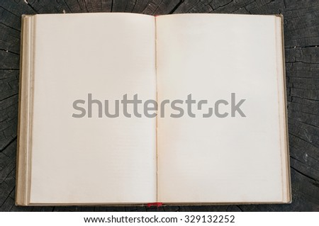 open vintage notepad closeup on wooden surfaces. Copy space. Free space for text - stock photo