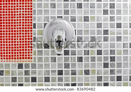 Open water in the bathroom with mosaic tiles in the background - stock photo